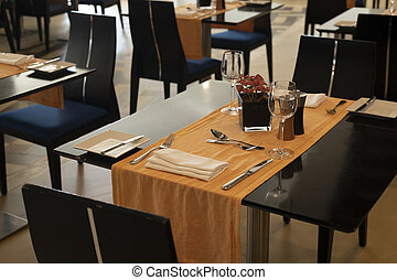 Fragment of interior in restaurant with tables