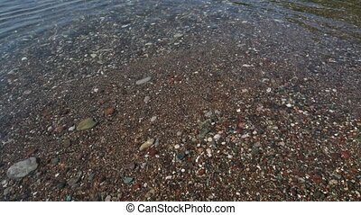 Fragment of Mediterranean Sea coast with a pebble beach -...