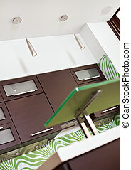 Fragment of modern Kitchen interior with hardwood furniture