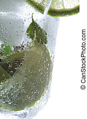 Fragment of mojito cocktail glass