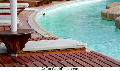 Fragment of nice luxury resort hotel with beautiful swimming...