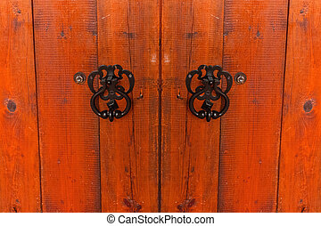 Fragment of old weathered wooden gate