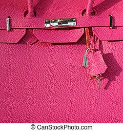 fragment of pink leather handbag