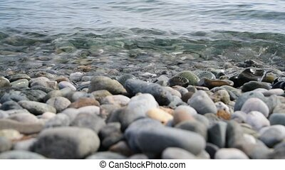 Fragment of sea coast with a pebble beach