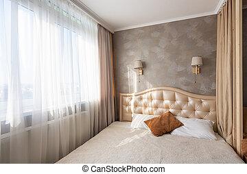 Fragment of the bedroom interior, bed, window, lamps