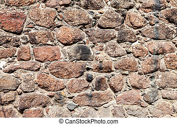 Fragment of the old stone wall as background