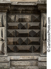 Fragment of the wall of the building with a black stone finish