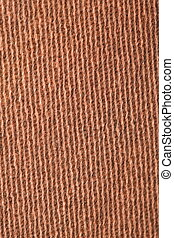fragment pile carpet, brown-yellow with pattern, parallel lines. macro shooting