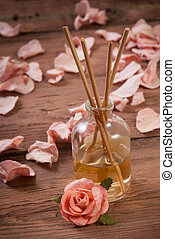 Fragrance sticks or Scent diffuser with rose flowers on...