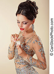 Fragrance. Young Woman with Perfume Bottle