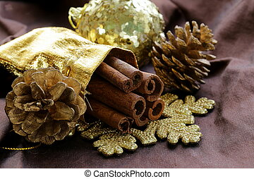fragrant cinnamon sticks in gold Christmas decorations