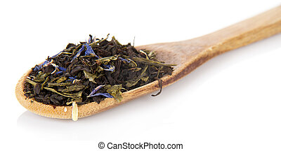 Fragrant dry tea leaves with cornflowers in the wooden...