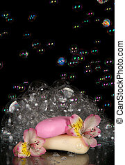 Fragrant foam, flower alstroemeria and piece of soap ...