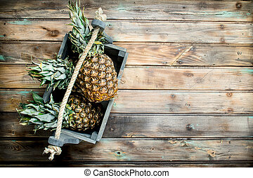 Fragrant pineapples in the box.
