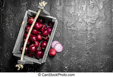 Fragrant red onion in the box.