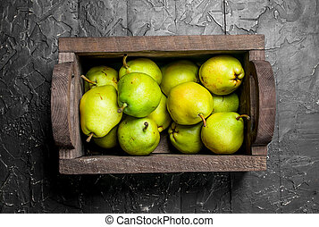 Fragrant ripe pears in the box.