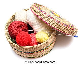 frail of knitting tools - frail full of multicilored balls...