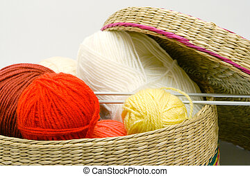 frail of knitting tools - frail full of multicolored balls...