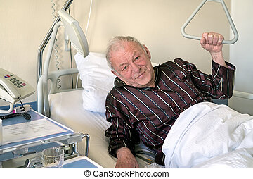 Frail senior man in a hospital bed propping himself up on...