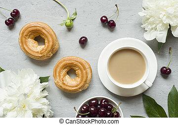 Frame custard cakes cherry flowers peony notepad tea Cup. Flatlay