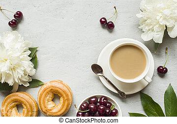 Frame custard cakes cherry flowers peony tea Cup. Copy space,