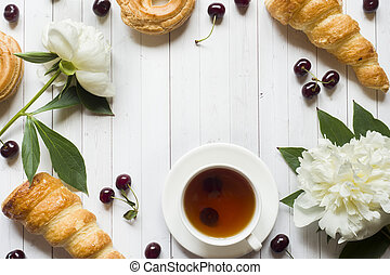 Frame custard cakes cherry flowers peony tea Cup. Copy space