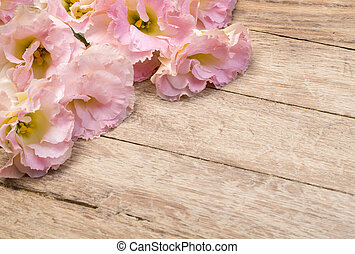 flowers on aged wooden background