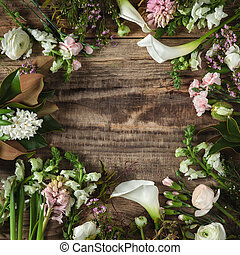 Frame from flowers on wooden background
