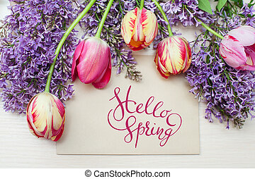 frame from tulips and lilac place for text greeting card with letters Hello sprint