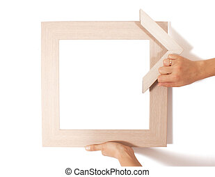 Frame in hands on white background