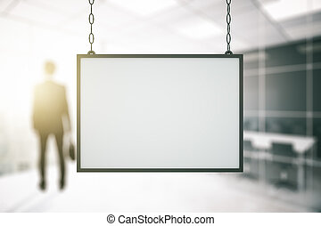 Frame in office with blurry businessman