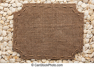Frame made of burlap with stitches and place for your text lying