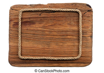 Frame made of rope lies on an old wooden board. Isolated