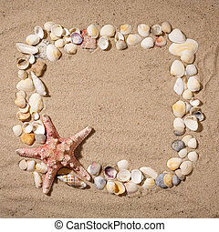 Frame made of stars and seashells on the sand, with place for your image, text.