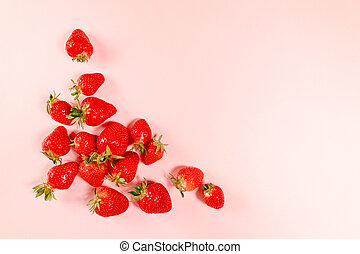 Frame made with organic and tasty strawberries on pnk ...