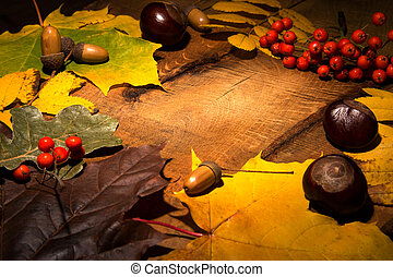 Frame of Autumn maple leaves on aged wood with copy space. Mockup for seasonal offers and holiday post card,