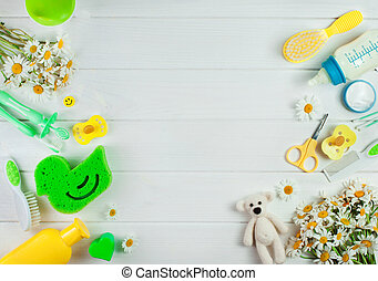Frame of baby accessories over white wooden background - ...