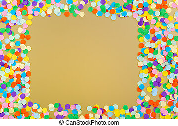 Frame of colorful confetti on yellow background.