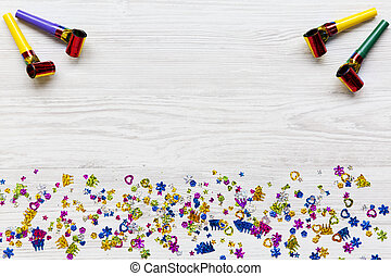 Frame of decoration party on white wooden background, overhead. Flat lay, from above, top view. Copy space.