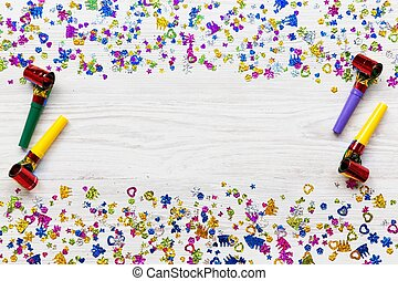 Frame of decoration party on white wooden background, overhead. Flat lay, from above, top view.