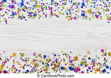Frame of decoration party on white wooden background, overhead. Flat lay, from above, top view. Space for text.