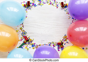 Frame of decoration party on white wooden background, top view. Flat lay, overhead, from above. Copy space.
