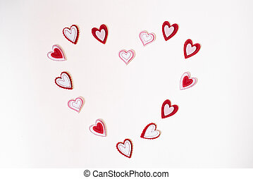 Frame of felt hearts on a white background with copying space