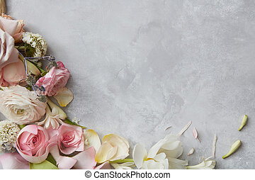 Frame of flowers decorating grey background. Top view of ...