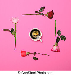 Frame of fresh colorful roses on pastel pink background with perfect coffee cup in middle - Flat lay