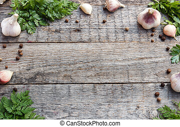 Frame of garlic green pepper on wooden background. Selective focus. Copy space.