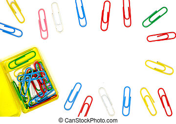 Frame of multicolour of paperclips on white background