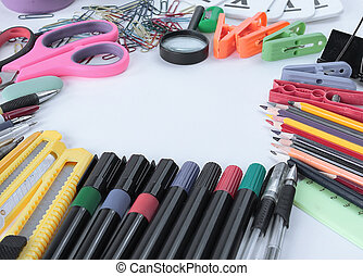 frame of office supplies on white background .photo with copy space