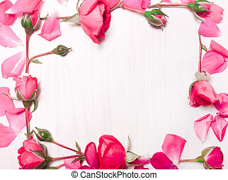 frame of pink flowers on a white background.Flat lay, top view