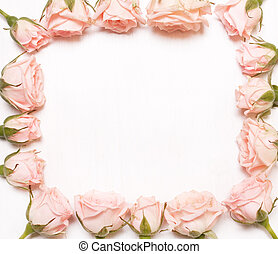 frame of pink flowers on white background.